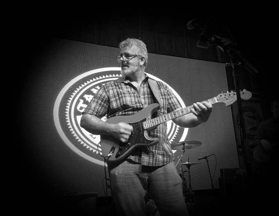 Ivan Duke in Stage holding a guitar